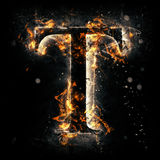Fire letter T. For your design Stock Photography