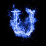 Fire letter U of burning flame light. Fire letter U of burning blue flame. Flaming burn font or bonfire alphabet text with sizzling smoke and fiery or blazing Stock Photos