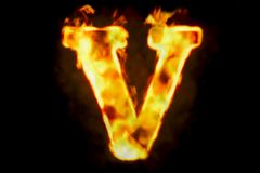Fire letter V of burning flame light, 3D rendering. Isolated on black background Stock Photos