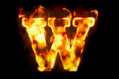 Fire letter W of burning flame light, 3D rendering. Isolated on black background Stock Photos