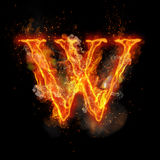Fire letter W of burning flame light. Fire letter W of burning flame. Flaming burn font or bonfire alphabet text with sizzling smoke and fiery or blazing shining Royalty Free Stock Image