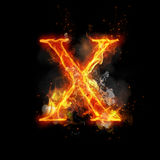 Fire letter X of burning flame light Royalty Free Stock Photo