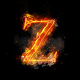 Fire letter Z of burning flame light. Fire letter Z of burning flame. Flaming burn font or bonfire alphabet text with sizzling smoke and fiery or blazing shining Stock Images
