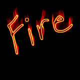 Fire Letters. The word fire written in vivid flames of orange, red, and yellow on a black background Royalty Free Stock Photos
