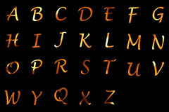Fire letters. On black background Stock Photos