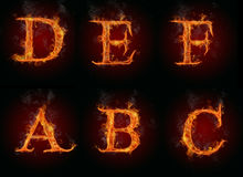 Fire letters. Collection of burning letters symbols, isolated on black background Royalty Free Stock Photography