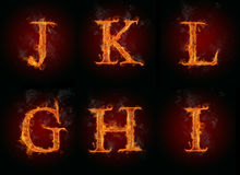 Fire letters. Collection of burning letters symbols, isolated on black background Stock Image