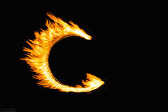 Fire letters. Letters painted by fire at night stock photography