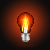 Fire in light bulb. Flame in light bulb on a dark background. Realistic vector illustration Royalty Free Stock Images