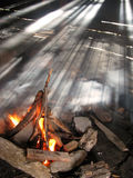 Fire and light rays. In an old sheepfold Stock Images