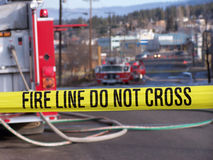 Fire Line Do Not Cross. A fire truck at a fire scene Stock Photography