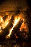 Fire lit in the fireplace Royalty Free Stock Photography