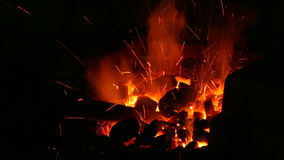 Fire, live coals and blacksmith`s tools. stock footage