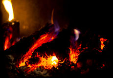 Fire. Log burning stove for heating in bath Royalty Free Stock Photos