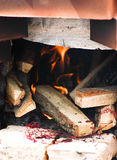 Fire logs in a fireplace Stock Photography