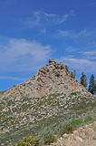 Fire lookout tower. Lookout tower sits atop lofty rock hill stock images