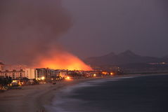 Fire Los Cabos Baja California sur Mexico. Suspected forest fire in estuary close to the new marina and Luxury resorts in San Jose Del cabo Mexico royalty free stock image