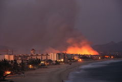 Fire Los Cabos Baja California sur Mexico 2. Suspected forest fire in estuary close to the new marina and Luxury resorts in San Jose Del cabo Mexico stock photography