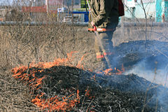 Fire man on forest fire Stock Photography
