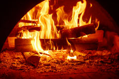 Fire in mantelpiece. Fire burning in the chimney, cozy sweet home concept Stock Photo