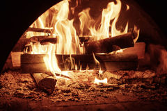 Fire in mantelpiece. Fire burning in the chimney, cozy sweet home concept Royalty Free Stock Photography