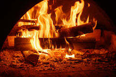 Fire in mantelpiece. Fire burning in the chimney, cozy sweet home concept Stock Image