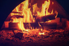Fire in mantelpiece. Fire burning in the chimney, cozy sweet home concept Royalty Free Stock Photo