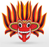 Fire Mask - Wooden Mask from Sri Lanka. Sri Lankan traditional Fire Devil mask. The Fire Devil, Gini Raksha, is supposed to subdue enemies and bring friendship royalty free stock images
