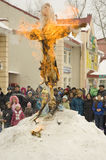 Fire the Maslenitsa doll. Bye to winter. PODOLSK, RUSSIA - FEB 26: Unidentified people is fire the Maslenitsa Doll on  Russian holiday Maslenitsa on a square in Stock Image
