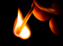 Fire from match royalty free stock photography