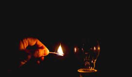 Fire match. And incandescent light on black background Stock Images