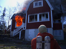 Fire men in action, house burning Stock Photo
