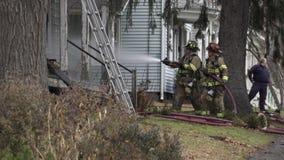 Fire Men Using a Hose to Battle a Fire stock video footage