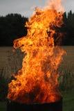 Fire in metal drum stock photos