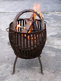 Fire in a metal fire basket Stock Images