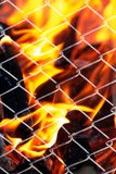 Fire in a metal grid. Photo of an abstract texture Royalty Free Stock Images