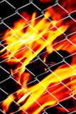 Fire in a metal grid. Photo of an abstract texture Royalty Free Stock Photos