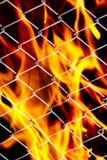Fire in a metal grid. Photo of an abstract texture Royalty Free Stock Image