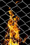 Fire in a metal grid. Photo of an abstract texture Royalty Free Stock Photography