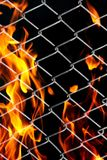 Fire in a metal grid. Photo of an abstract texture Stock Photos