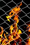 Fire in a metal grid. Photo of an abstract texture Stock Photography