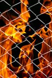 Fire in a metal grid. Photo of an abstract texture Stock Image