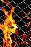 Fire in a metal grid. Photo of an abstract texture Royalty Free Stock Photo