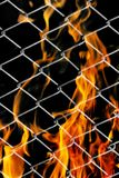 Fire in a metal grid. Photo of an abstract texture Stock Photo