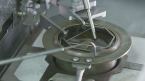 Fire on metal tube moved over round gas tool close view. Closeup interesting lab examination test with fire on metal tube moving over round gas tool on lab table stock video footage