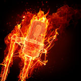 Fire microphone. Burning microphone and black background Royalty Free Stock Images