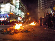 Fire in the middle of demonstrators Royalty Free Stock Photography
