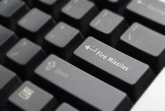 Fire Missiles Keyboard Detail. Close-up of computer keyboard with Fire Missles key replacing Enter key Royalty Free Stock Image