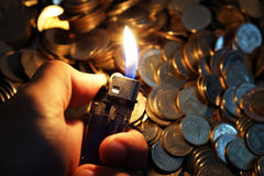 Fire and money Stock Images