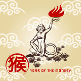 Fire Monkey. The monkey sitting on a branch with fire in the hand. Symbol of 2016 year with chinese wording Royalty Free Stock Photography